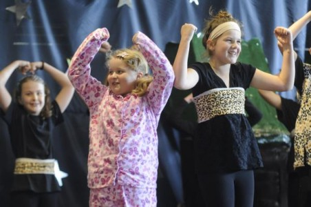 Lang Lang Primary School students had fun during their school performance last Thursday. From left; Roxanne as Lucy danced on stage with Abbey.   Pictures: STEWART CHAMBERS 126275_15