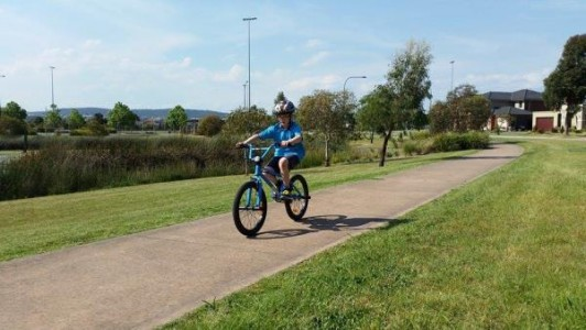 129676_01 Josh's dad is relieved his son can safely ride his bike around Pakenham. Picture: CONTRIBUTED