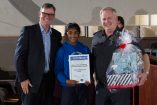 Berwick Primary School's Tiana with MFB chief Jim Higgins, left, and MFB commander Paul Foster right.