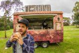 Gippsland Food Truck Carnival organiser Danny Grant tucks in.