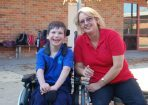 Pakenham Consolidated student Jackson Fitzsimmonds with his aide, Donna Fromhold.