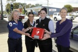 Ambulance Victoria First Responder  Rosie Keane, IGA staff Kellie Mascarri and Katelyn Bjorksten and Bendigo Bank Lang Lang representative Tania Hansen with one of the newly installed defibrillators 147473 Picture: STEWART CHAMBERS
