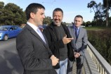 Gembrook MP Brad Battin, Angelo D'Amelio and Councillor Brett Owen overlook the Monash Freeway. 122870 Picture: STEWART CHAMBERS