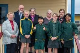 Long-time St Patrick's Primary School parent and grandparent Bev Hind, school principal Mick O'Brien, past student and principal Sister Kathleen O'Neill , past student and parish secretary Mary Craven and past student Joan Lewis with current students Sophie, Shawn, Keely and Ashreena outside the school's oldest building which dates back to the 1920s. 154527 Picture: GARY SISSONS.