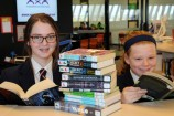St Francis Xavier College Year 8 student Emaleigh and Year 7 student Samara getting stuck into a good book. 157272_01 Picture: STEWART CHAMBERS