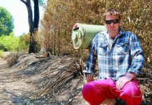 Paul Reynolds on the scorched front boundary of his Reynolds Road property, just metres from his house.
