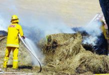 Firefighters worked for hours to ensure a hay bale fire did not spread last Thursday.